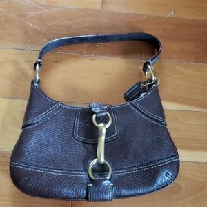 Small brown Coach hobo bag with buckle